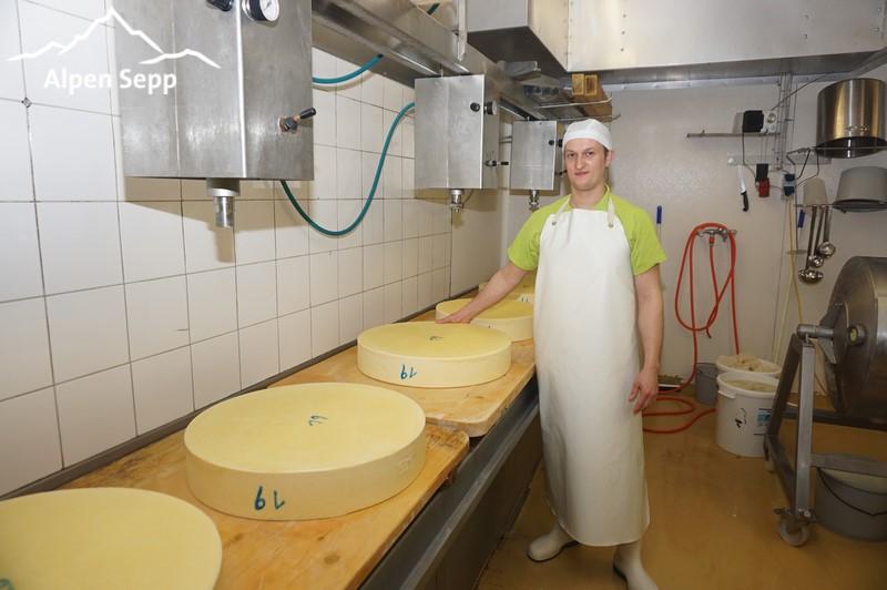 Fresh hay milk mountain cheese wheels